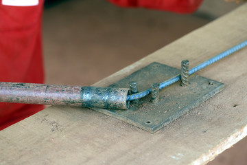 Construction worker assembling iron frame