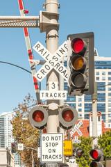 Urban railroad crossing signal and lit stoplight