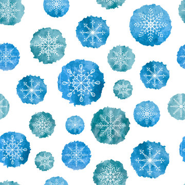 Snowflakes seamless pattern. White snowflakes on blue watercolor backgrounds. Vector illustration.