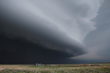 A massive dark supercell on the high plains of eastern Colorado.