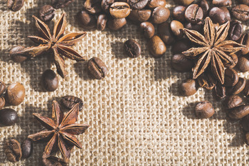 Coffee beans on sackcloth with spices anise
