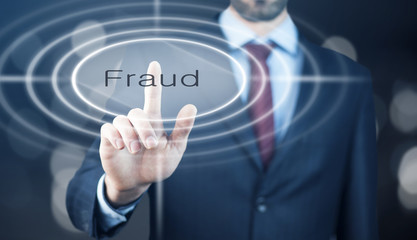 Businessman pressing Fraud