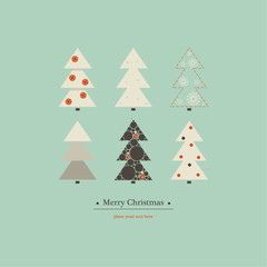 Cover design for  Merry Christmas. The depicts six Christmas trees of different design on a blue background and the phrase  merry Christmas underneath.