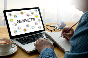 GAMIFICATION Businessman working at office desk and using comput