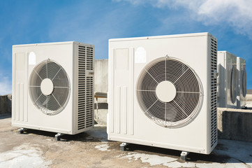 air conditioners installation outside on the floor with blue sky