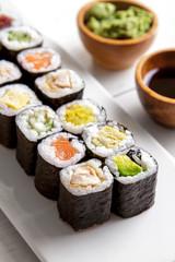 japanese food mini maki sushi platter on white wooden table