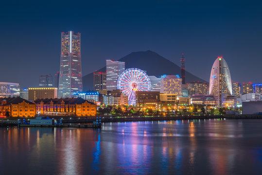 Yokohama city skyline over the Mt Fuji at sunset time..