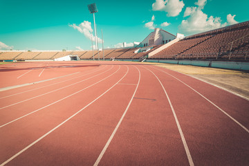 Red running track in stadium , vintage Wall mural