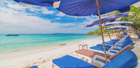 Beach chair and umbrella on the beach , Koh larn , Thailand