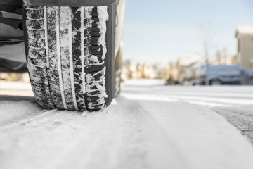 Car tire on snowy winter road