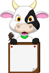 cute cow cartoon posing with blank sign
