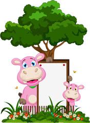 funny two hippo cartoon with blank sign in flower garden