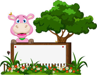 funny hippo cartoon with blank sign in flower garden