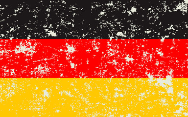 Flag Of Germany. Three colors of golden, red, black. Shabby background. Grunge texture.