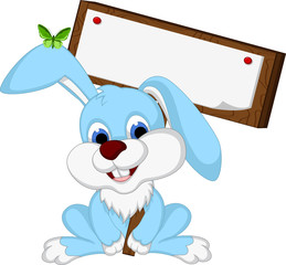 rabbit cartoon posing with blank sign
