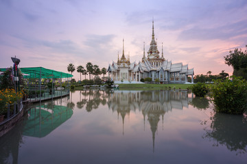 Wat Luang Pho Toh temple with water reflection in twilight time,