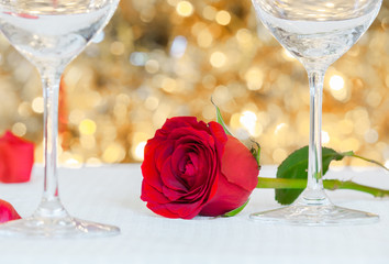 Red rose on a table. Romantic dinning and date night concept.