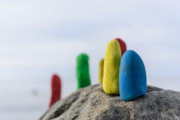Coloured stones on coast