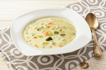 Vegetarian soup with zucchini, carrot and potatoes.