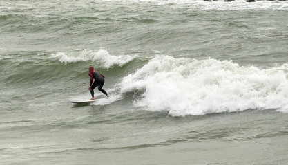 a surfer surf a wave in italy