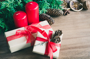 Christmas Presents in Rustic Style With Holiday Decorations. Xmas Composition on Wooden Background.