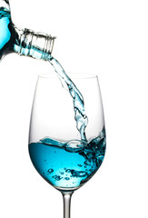 Blue wine was poured, spread isolated white background.