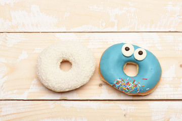 Funny glazed donuts on vintage background