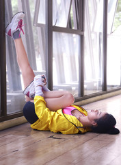 Asian young female stretching her calf muscle as warming up