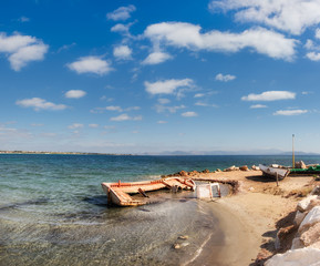 Old fisherman boats on the shore of Aegean sea