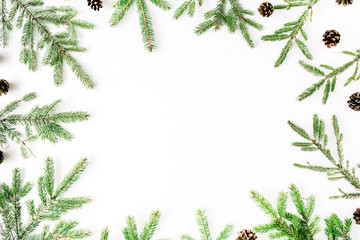 Christmas composition with frame of fir branches and pine cones. Flat lay, top view