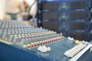 close-up of the control buttons on a music mixer