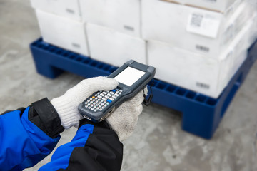 Bluetooth barcode scanner checking goods in the cold room or warehouse