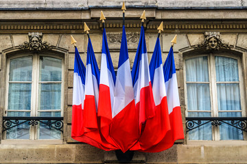 Building decorated with Flags of French Republic. Paris, France.