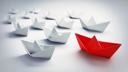 Papierschiff-Flotte mit rotem Leader 2