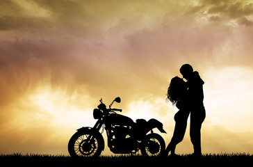 couple kissing on motorcycle