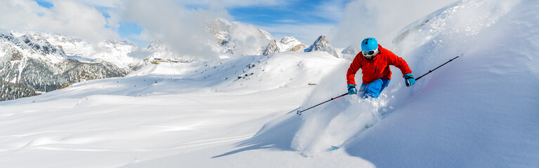 Poster Winter sports Skier skiing downhill in high mountains in fresh powder snow. Sa