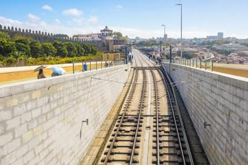 Porto Oporto metro subway tram train railway bridge Douro river rail electric deck cables sunny day