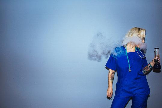 Young blonde nurse smoking pot