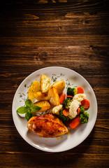 Fried chicken fillet and vegetable salad