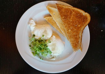 English breakfast of poached eggs and brown toast