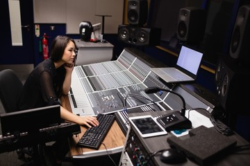 Female student using sound mixer