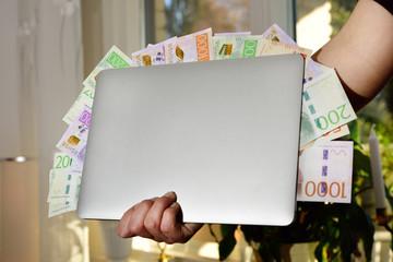 Swedfish money and laptop