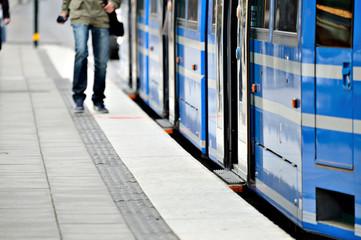 Man running to enter tram