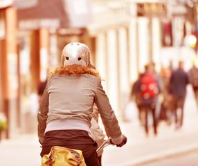 Fototapete - Bicyclist with helmet in traffic