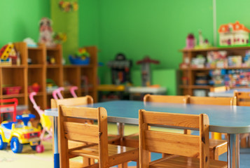 Chairs, table and toys. Interior of kindergarten.