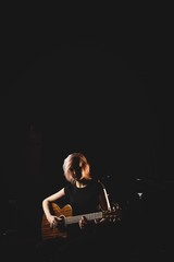 Female student playing guitar