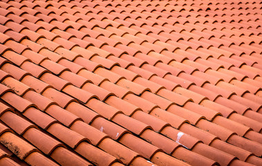 Red roof tiles or shingles on house as background image.