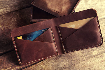 Leather wallet on wooden background