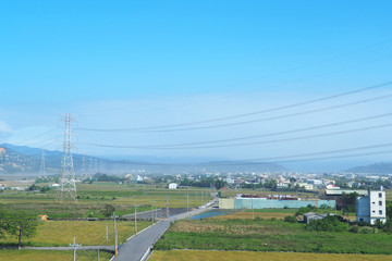 High voltage transmission towers in urban town of Taiwan.