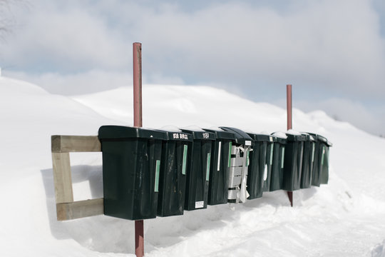 Row of mail boxes on snow covered field